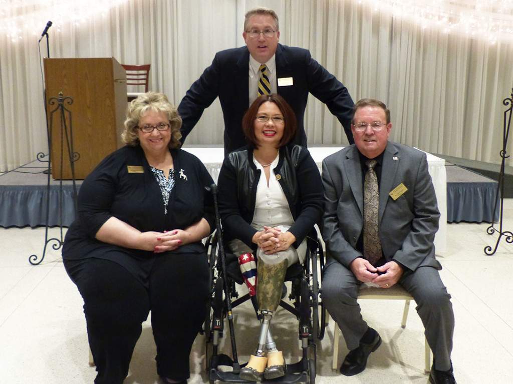 2015 Jefferson Jackson Dinner Keynote speaker U.S. Rep. Tammy Duckworth is pictured with, from left, Will County Democratic Central Committee Secretary Karen Gonzalez, Chairman Scott Pyles and Treasurer Kevin Clancy. Jennifer Rice/staff photographer