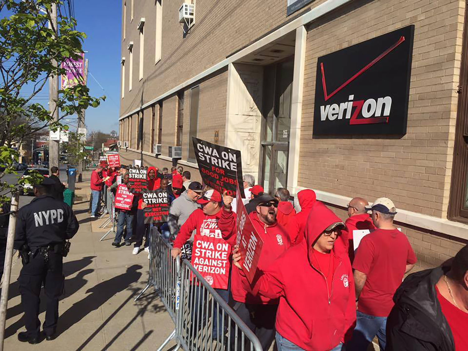 Communication Workers of America members march on strike against Verizon in New York